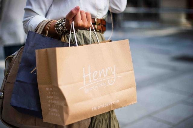 a woman taking a shopping bag