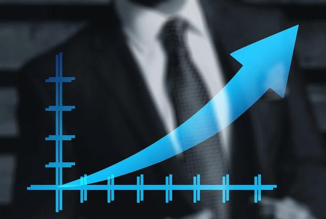 ビジネスマンと上昇傾向の表