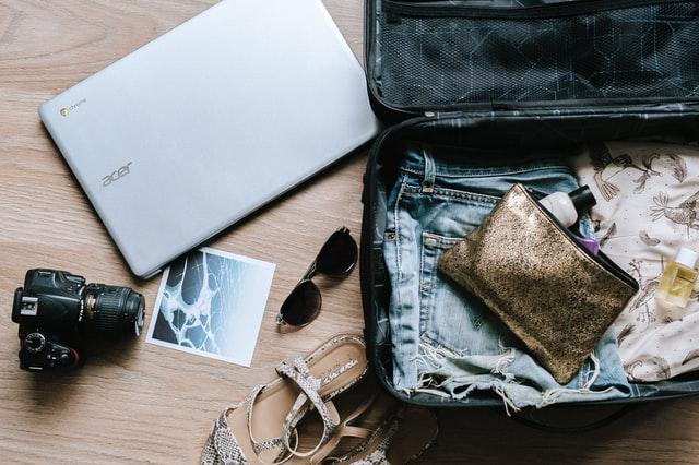 suitcase , laptop, camera, etc.